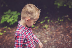 Side portrait of cute little boy child outdoors on Stock Photography