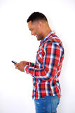 Side portrait handsome black young man looking at cellphone Stock Image
