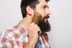 Side portrait of handsome caucasian man with funny mustache smile and comb his big Royalty Free Stock Photography