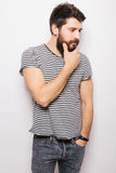 Side Portrait handsome young man with  hand on beard smiling Stock Photography