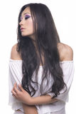 Side portrait of a model with long black hair Royalty Free Stock Photos