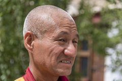 Side portrait of an old Tibetan Buddhist monk Royalty Free Stock Photo