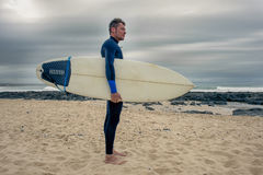 Side Portrait of Surfer Stock Photography