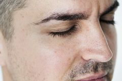 Side portrait of white man closeup on closed eyes stock photos