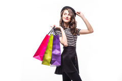 Side portrait of young happy smiling woman with shopping bags isolated over white background Stock Photography