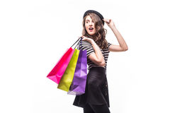 Side portrait of young happy smiling woman with shopping bags isolated over white background Stock Photo