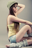 Side pose of beautiful model sitting Royalty Free Stock Photo