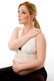 Side pose of blonde pregnant female doing exercise Royalty Free Stock Photography