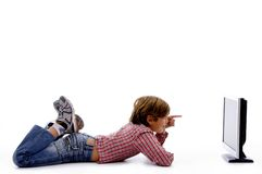 Side pose of boy watching screen stock image