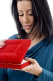 Side pose of female looking in jewellery box Stock Images