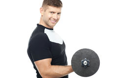Side pose of gym instructor lifting weights Stock Image