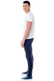 Side pose image of young smart guy. Handsome young stylish guy posing against white Royalty Free Stock Photo