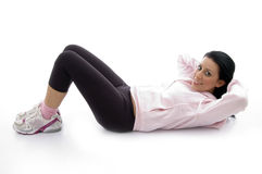 Side pose of laying exercising female Stock Photography