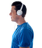 Side pose of a man with headphones Royalty Free Stock Image