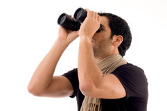Side pose of man looking through binocular Stock Photography