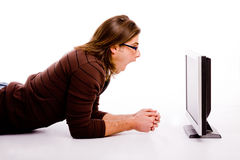 Side pose of man playing videogame Stock Images