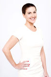 Side pose of middle aged woman. Royalty Free Stock Photography