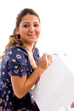 Side pose of model holding shopping bags Stock Photography