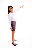Side pose of pointing woman looking at camera Stock Photos
