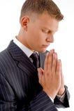 Side pose of praying businessman Royalty Free Stock Image