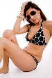 Side pose of sexy woman wearing sunglasses Royalty Free Stock Image