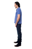 Side pose of smart young man, studio shot Stock Photography