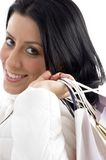Side pose of smiling woman carrying shopping bags Stock Images
