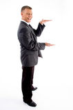 Side pose of standing measuring businessman Stock Images