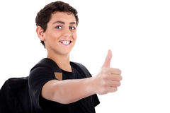 Side pose of teenager shows thumbs up Royalty Free Stock Images