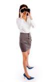 Side pose of woman looking through binocular Royalty Free Stock Images