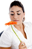 Side pose of woman looking the flower stock photo