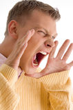 Side pose of yelling male. With white background Royalty Free Stock Photo