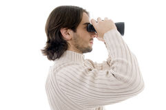 Side pose of young man watching through binocular Royalty Free Stock Image
