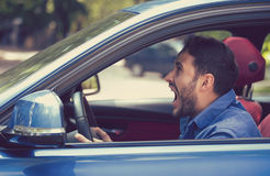 Side profile angry driver. Negative emotions face expression. Side profile angry driver. Negative human emotions face expression Stock Image