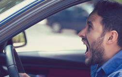 Side profile angry driver. Negative human emotions face expressi. Angry driver. Negative human emotions face expression Royalty Free Stock Photos
