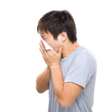 Side profile of asia man sneeze Stock Image