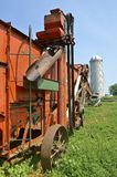 Side profile of belted threshing machine Royalty Free Stock Photos
