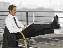Side profile of a businessman using a laptop Stock Image