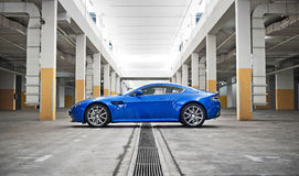 Side profile of car. Side profile of a sports car in a carpark Royalty Free Stock Photo