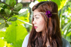 Side profile of Filipina woman in a garden Royalty Free Stock Image