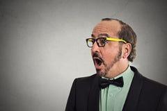 Side profile headshot surprise astonished man Stock Image