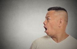 Side profile middle aged man speaking Stock Images