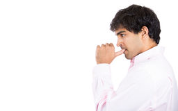 Side profile portrait of man with finger in mouth sucking thumb or biting fingernail in anxiety and stress Royalty Free Stock Images