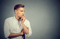 Side profile preoccupied anxious young man royalty free stock images