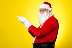 Side profile of Santa facing camera Stock Photo