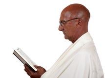 Senior man reads book Royalty Free Stock Image