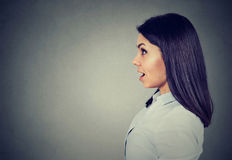 Side profile of a shocked young woman royalty free stock photography