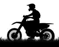 Side profile silhouette of off road biker with scrambler. On grass Stock Photos