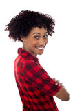 Side profile of slim young smiling woman, arms crossed Stock Photo