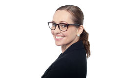 Side profile of a woman wearing spectacles Stock Images